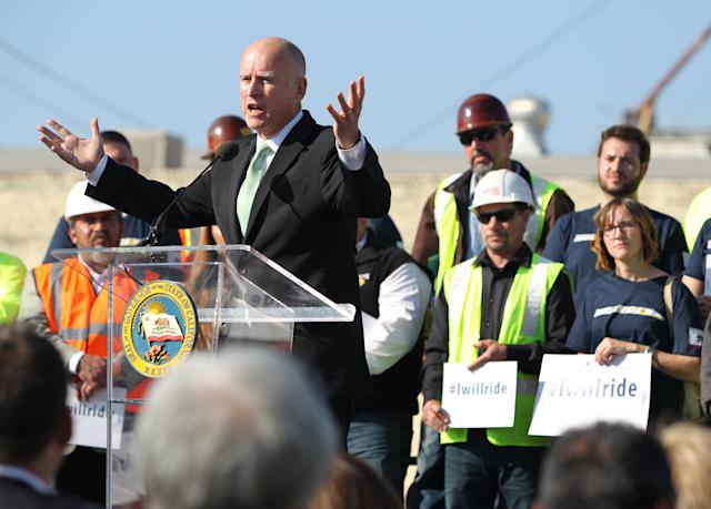 Gov. Jerry Brown speaks to the crowd during the California High Speed Rail Authority ground breaking event Tuesday, Jan. 6, 2015 in Fresno, Calif. The $68 billion project faces challenges from Republicans in Congress eager to reduce government spending and Central Valley farmers suing to block the train from crossing their fields. The train would whisk travelers at 200 mph between Los Angeles and San Francisco in less than three hours. (AP Photo/Gary Kazanjian)