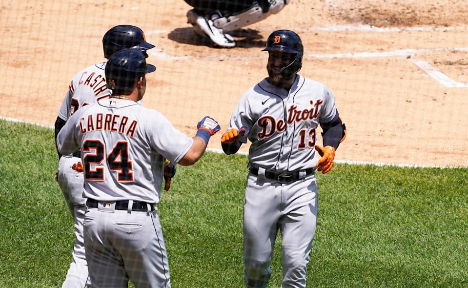Tigers left fielder Eric Haase is congratulated by designated hitter Miguel Cabrera after hitting a two-run home run against the White Sox during the second inning on Saturday, June 5, 2021, in Chicago.