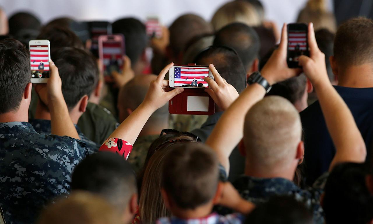 <p>U.S. military personnel take pictures of U.S. President Donald Trump as he delivers remarks at the Naval Air Station Sigonella following the G7 Summit, in Sigonella, Sicily, Italy, May 27, 2017. (Photo: Darrin Zammit Lupi/Reuters) </p>