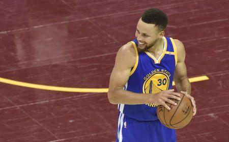 Jun 7, 2017; Cleveland, OH, USA; Golden State Warriors guard Stephen Curry (30) smiles during the fourth quarter against the Cleveland Cavaliers in game three of the 2017 NBA Finals at Quicken Loans Arena. Mandatory Credit: David Richard-USA TODAY Sports
