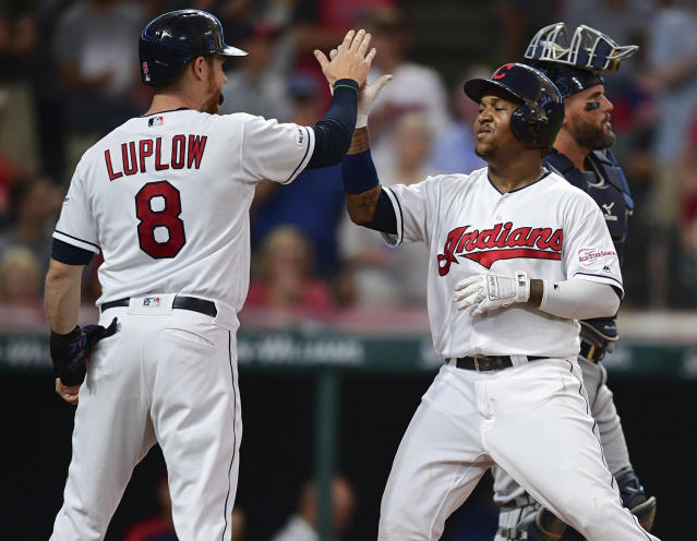 Cleveland Indians' Jose Ramirez, right, is congratulated by Jordan Luplow after hitting a two-run home run off Detroit Tigers starting pitcher Matthew Boyd during the sixth inning of a baseball game Thursday, July 18, 2019, in Cleveland. (AP Photo/David Dermer)