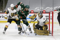 Vegas Golden Knights goaltender Marc-Andre Fleury (29) blocks a shot by Minnesota Wild left wing Jordan Greenway (18) while Golden Knights' Shea Theodore (27) defends during the second period of an NHL hockey game, Wednesday, May 5, 2021, in St. Paul, Minn. (AP Photo/Andy Clayton-King)