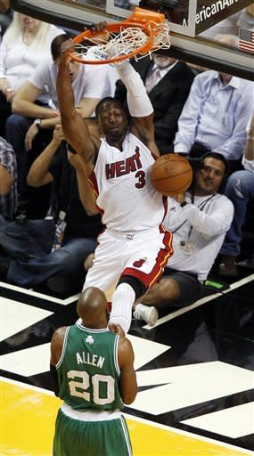 Miami Heat's Dwyane Wade (3) dunks over Boston Celtics' Ray Allen (20) during the first half of Game 5 in their NBA basketball Eastern Conference finals playoffs series, Tuesday, June 5, 2012, in Miami. (AP Photo/Wilfredo Lee)