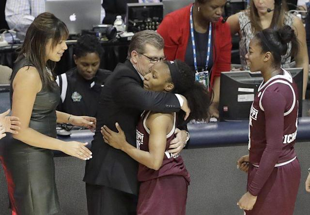 Geno Auriemma embraced Morgan William after the MSU guard beat UConn at the buzzer. (Getty)