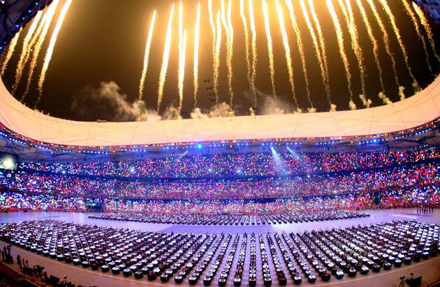 BEIJING - AUGUST 08:  Fireworks go off during the Opening Ceremony for the 2008 Beijing Summer Olympics at the National Stadium on August 8, 2008 in Beijing, China.  (Photo by Alexander Hassenstein/Bongarts/Getty Images)