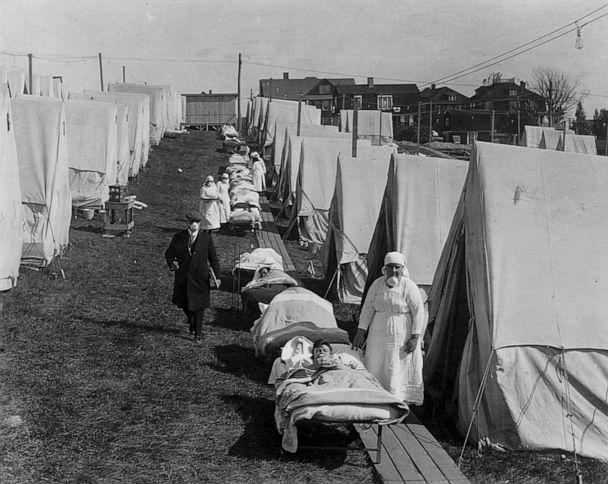 PHOTO: In this October, 1918, file photo, tents and patients are shown at an emergency hospital to care for influenza cases, Brookline, Mass. (Photoquest/Getty Images)