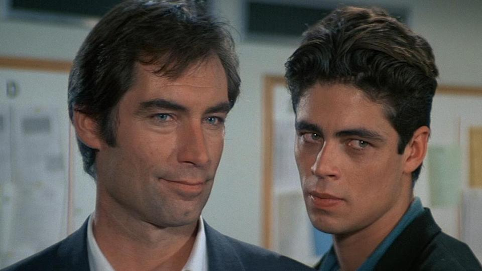 <p> This is 007, but not as you know him. Timothy Dalton goes all-out to provide an edgier, more erratic Bond in this under-appreciated classic. We've seen Bond go rogue before and since – but nothing quite like this. Sub-par theme song aside, License to Kill doesn't let up from start to finish. Gone are the one-liners and other trappings of the series and, in its stead, we have BFFs being fed to sharks, a wedding gone horribly, horribly wrong, and an explosive finish to rival any action film, Bond or otherwise. It's all topped off by a villain you'll love to hate to in Franz Sanchez. Here is an absolutly horrid man who smugly flits from scene-to-scene with an appreciative menace, and gets probably the greatest villain comeuppance in the entire Bond canon: being burnt to death with his own lighter after a miles-long tanker chase that's so crazy in scale that you can almost <em>see </em>the money being burned during production. Yes, this isn't the popular choice, but it laid the groundwork for Daniel Craig's efforts decades in advance and featured a proper, moody Bond that didn't go all soppy on us while getting from A to B. Plus, Benicio del Toro gets fed to a shredder, which is nice. </p> <p> <strong>Bond:</strong> Timothy Dalton<br> <strong>Theme tune:</strong> License to Kill by Gladys Knight </p>