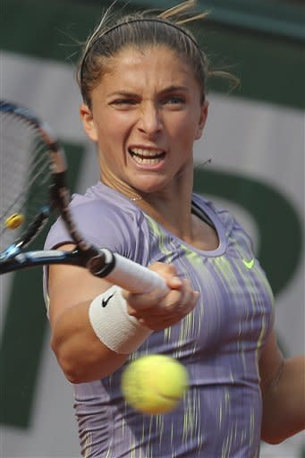 Italy's Sara Errani returns against Serena Williams of the U.S. in their semifinal match at the French Open tennis tournament, at Roland Garros stadium in Paris, Thursday June 6, 2013. (AP Photo/Michel Euler)