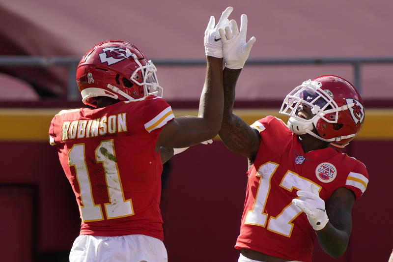Kansas City Chiefs wide receiver Demarcus Robinson (11) celebrates after scoring a touchdown against the Carolina Panthers. (AP Photo/Jeff Roberson)