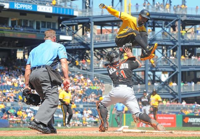 Andrew McCutchen, shown here attempting to jump to home plate, will leave Pittsburgh for San Francisco (AFP Photo/Justin Berl)