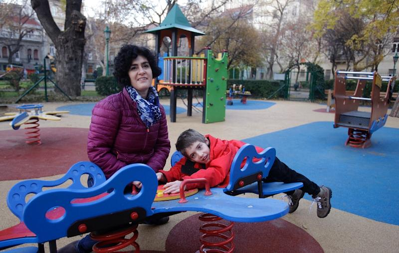 "Aron's mother Eszter Harsanyi says the equipment ""helps Aron a lot to mingle with able-bodied peers"" (AFP Photo/Peter Kohalmi)"