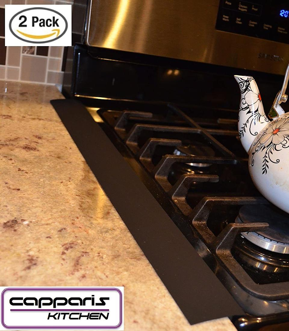 """You'd be surprised at how many stray crumbs make their way in that space between your stove and countertop.<br /><br />These are heat-resistant up to 446 degrees F, so you don't have to worry about them melting while you cook. They're easy to wipe clean but you can also toss them into the dishwasher.<br /><br /><strong>Promising review:</strong>""""I can't believe how much crud I have cleaned out between my counter and my stove. This lays in the opening between the two so nothing gets down the space between. Just lay it down very easily, and it stays put.<strong>It looks like it is part of the stove. It is easy to clean; just wipe off when you clean the stove or counter.</strong>I have had no problem with melting as it is not on the burners, it is on the side of the stove. However, it is heat resistant, so the heat from the stove will not bother it. I would definitely buy this again."""" —<a href=""""https://amzn.to/3mymQyE"""" target=""""_blank"""" rel=""""nofollow noopener noreferrer"""" data-skimlinks-tracking=""""5892474"""" data-vars-affiliate=""""Amazon"""" data-vars-href=""""https://www.amazon.com/gp/customer-reviews/R3O8JKH1K5CMVY?tag=bfdaniel-20&ascsubtag=5892474%2C32%2C33%2Cmobile_web%2C0%2C0%2C16507693"""" data-vars-keywords=""""cleaning"""" data-vars-link-id=""""16507693"""" data-vars-price="""""""" data-vars-product-id=""""15939843"""" data-vars-retailers=""""Amazon"""">Joanne</a><br /><br /><strong>Get a set of two from Amazon for<a href=""""https://amzn.to/2Rpd8mL"""" target=""""_blank"""" rel=""""nofollow noopener noreferrer"""" data-skimlinks-tracking=""""5892474"""" data-vars-affiliate=""""Amazon"""" data-vars-asin=""""B01CTNA1VI"""" data-vars-href=""""https://www.amazon.com/dp/B01CTNA1VI?tag=bfdaniel-20&ascsubtag=5892474%2C32%2C33%2Cmobile_web%2C0%2C0%2C16507738"""" data-vars-keywords=""""cleaning"""" data-vars-link-id=""""16507738"""" data-vars-price="""""""" data-vars-product-id=""""17872520"""" data-vars-product-img=""""https://m.media-amazon.com/images/I/31lIaDCM-DL.jpg"""" data-vars-product-title=""""Capparis Kitchen Silicone Stove Counter Gap Cover, Easy Clean Heat Resistant Wide & Lon"""