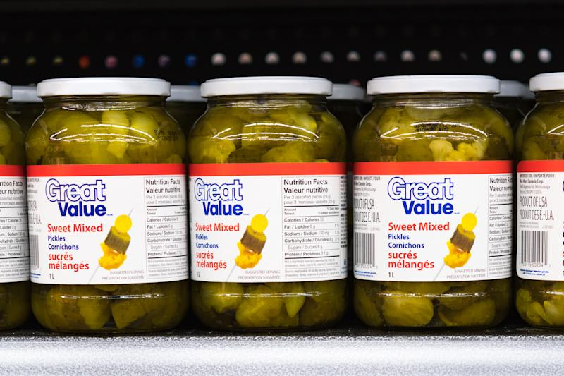 Great Value sweet mixed pickle jars on a store shelf. The