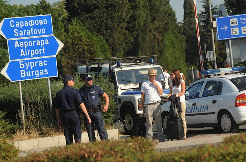 FILE - In this Thursday, July 19, 2012 file photo, foreign tourists wait to pass as police block the entrance of Burgas airport, Bulgaria, a day after a deadly suicide attack on a bus full of Israeli vacationers. Israel's prime minister said Sunday, July 22, 2012 that his country is on alert for plots to kill more of its citizens overseas, after speculation that last week's deadly bombing of a tour bus in Bulgaria was a rehearsal for a spectacular attack on Israel's Olympics team. (AP Photo, File) BULGARIA OUT