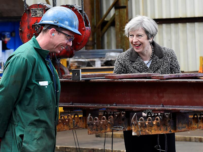 Prime Minister Theresa May speaks to a worker during a visit to a steel works in Newport, Wales: PA wire