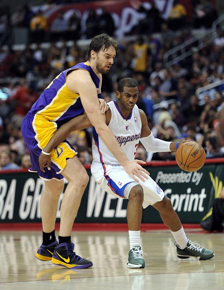 LOS ANGELES, CA - APRIL 04:  Chris Paul #3 of the Los Angeles Clippers keeps the ball from Pau Gasol #16 of the Los Angeles Lakers during a 113-108 Laker win at Staples Center on April 4, 2012 in Los Angeles, California.  NOTE TO USER: User expressly acknowledges and agrees that, by downloading and or using this photograph, User is consenting to the terms and conditions of the Getty Images License Agreement.  (Photo by Harry How/Getty Images)