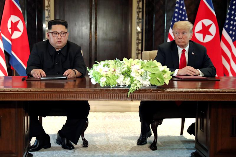 President Donald Trump and North Korean leader Kim Jong Un hold a signing ceremony at the conclusion of their summit in Singapore on Tuesday. Two lawmakers from Norway nominated Trump for the Nobel Peace Prize after the meeting. (Jonathan Ernst / Reuters)