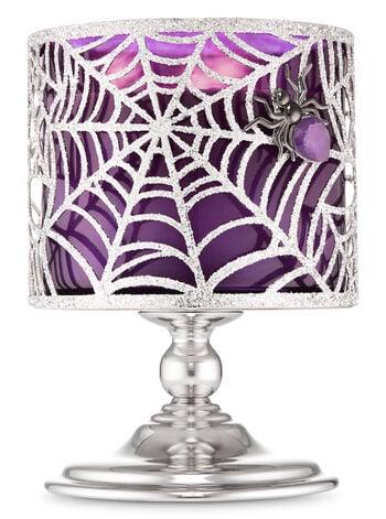 "<p>No candle is complete without a stand, which is why this <a href=""https://www.popsugar.com/buy/Sparkly-Spider-Web-Pedestal-3-Wick-Candle-Holder-478732?p_name=Sparkly%20Spider%20Web%20Pedestal%203-Wick%20Candle%20Holder&retailer=bathandbodyworks.com&pid=478732&price=16&evar1=bella%3Aus&evar9=46489148&evar98=https%3A%2F%2Fwww.popsugar.com%2Fbeauty%2Fphoto-gallery%2F46489148%2Fimage%2F46489306%2FSparkly-Spider-Web-Pedestal-3-Wick-Candle-Holder&list1=shopping%2Cbeauty%20products%2Challoween%2Cfall%2Cbath%20and%20body%20works%2Cfall%20beauty&prop13=api&pdata=1"" rel=""nofollow"" data-shoppable-link=""1"" target=""_blank"" class=""ga-track"" data-ga-category=""Related"" data-ga-label=""https://www.bathandbodyworks.com/p/sparkly-spider-web-pedestal-3-wick-candle-holder-024512115.html?cgid=halloween#sz=48&amp;start=2"" data-ga-action=""In-Line Links"">Sparkly Spider Web Pedestal 3-Wick Candle Holder</a> ($16) is a must.</p>"