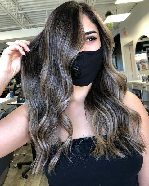 """<p>There's <strong>so much dimension and <a href=""""https://www.cosmopolitan.com/style-beauty/a8985131/how-to-make-hair-shiny/"""" rel=""""nofollow noopener"""" target=""""_blank"""" data-ylk=""""slk:shine"""" class=""""link rapid-noclick-resp"""">shine</a> going on in this ash-brown hair color</strong>, which really brings out the deep-brown base. (Psst: Swipe through for this colorist's pretty epic before-and-after shot).</p><p><a href=""""https://www.instagram.com/p/CDjIxhGhwWL/"""" rel=""""nofollow noopener"""" target=""""_blank"""" data-ylk=""""slk:See the original post on Instagram"""" class=""""link rapid-noclick-resp"""">See the original post on Instagram</a></p>"""