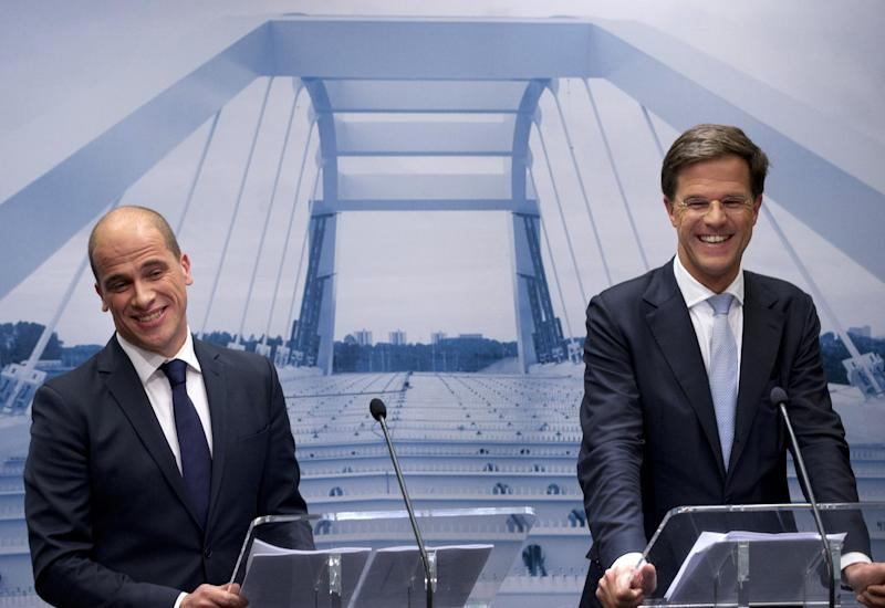 "Caretaker Prime Minister Mark Rutte, right, and Labor Party Leader Diederik Samsom, left, smile in front of a picture symbolizing the theme of the new government, ""building bridges"", during a joint press conference in The Hague, Netherlands, Monday Oct. 29, 2012. The Netherlands is close to getting a new coalition government after lawmakers from the two biggest parties approved a policy deal hammered out by their leaders. Rutte, leader of the pro-free market VVD party, and center-left Labor Party chief Samsom have been negotiating behind closed doors for weeks to resolve policies for their proposed coalition. (AP Photo/Peter Dejong)"
