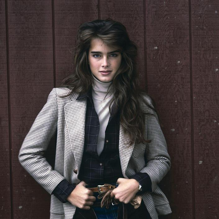 <p>Brooke Shields poses in a turtleneck and checked blazer. </p>