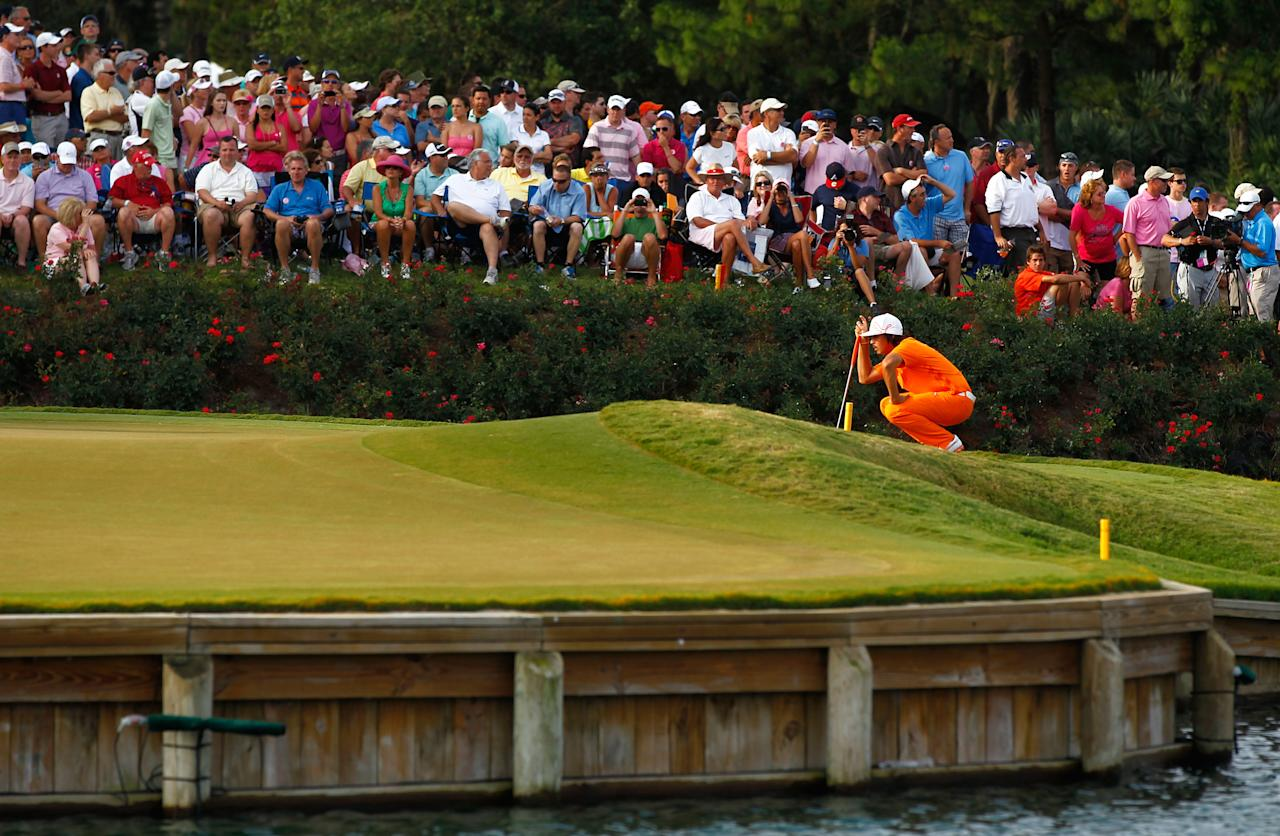 PONTE VEDRA BEACH, FL - MAY 13: Rickie Fowler of the United States lines up his putt on the 17th green during the final round of THE PLAYERS Championship held at THE PLAYERS Stadium course at TPC Sawgrass on May 13, 2012 in Ponte Vedra Beach, Florida.  (Photo by Mike Ehrmann/Getty Images)