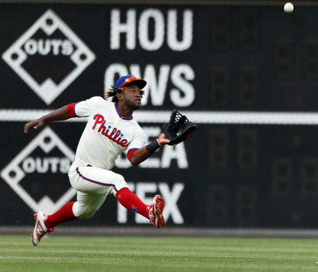 Philadelphia Phillies center fielder Odubel Herrera fields a fly by Pittsburgh Pirates left fielder Corey Dickerson during the seventh inning of a baseball game Saturday, April 21, 2018, in Philadelphia. The Phillies won 6-2. (AP Photo/Laurence Kesterson)