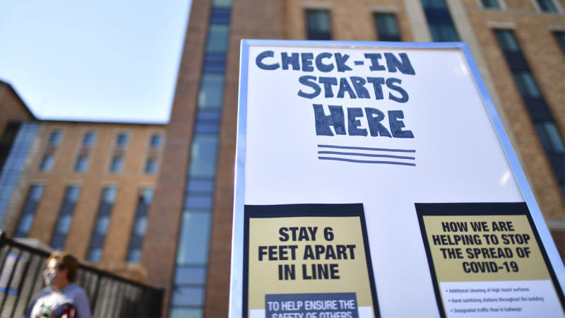 Placards advise physical distancing guidelines due to the coronavirus pandemic while directing incoming freshman moving into a campus dormitory at University of Colorado Boulder on August 18, 2020 in Boulder, Colorado. (Mark Makela/Getty Images)