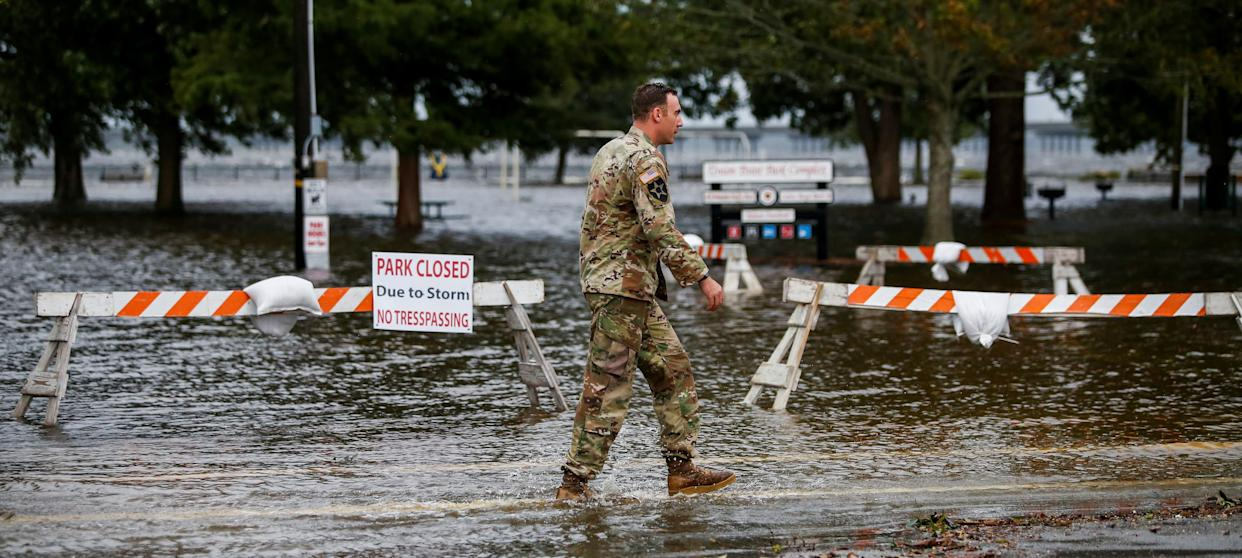 A U.S. Army member walks near the flooded Union Point Park Complex as Hurricane Florence comes ashore in New Bern on Thursday.