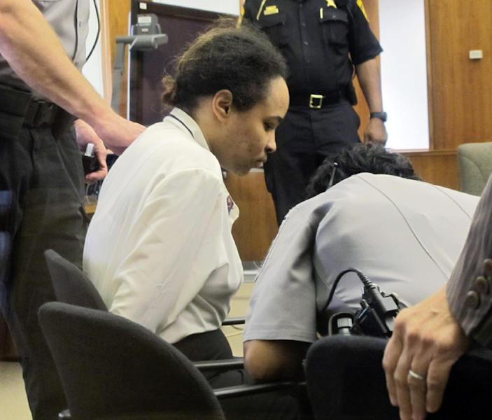 Annette Morales-Rodriguez waits for a deputy to release her leg chains in a Milwaukee court for the start of her trial on Monday, Sept. 17, 2012. She's accused of killing a young mother by cutting her full-term fetus from her womb last October. (AP Photo/Carrie Antlfinger)