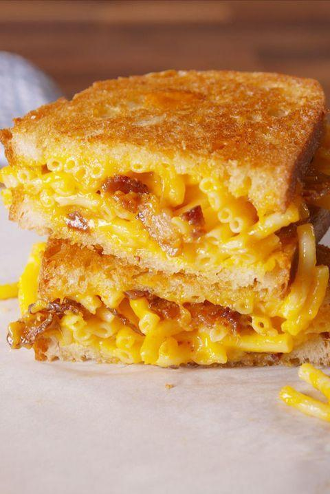 """<p>This recipe is pretty straight-forward. Mac and cheese grilled between two slices of bread. Pure, over-the-top comfort food. </p><p><strong><em>Get the recipe at <a href=""""https://www.delish.com/cooking/recipe-ideas/recipes/a49953/mac-cheese-grilled-cheese-recipe/"""" rel=""""nofollow noopener"""" target=""""_blank"""" data-ylk=""""slk:Delish."""" class=""""link rapid-noclick-resp"""">Delish.</a></em></strong></p>"""