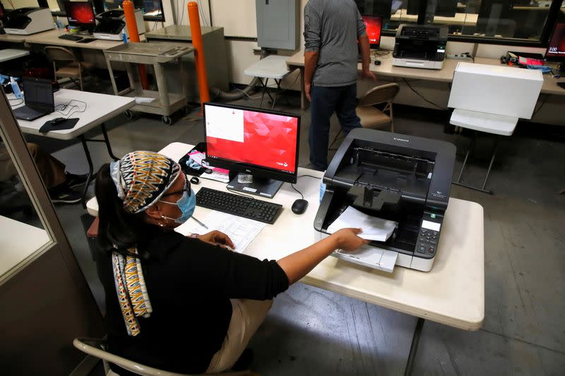 A county election worker tabulates ballots at the Clark County Election Center in North Las Vegas