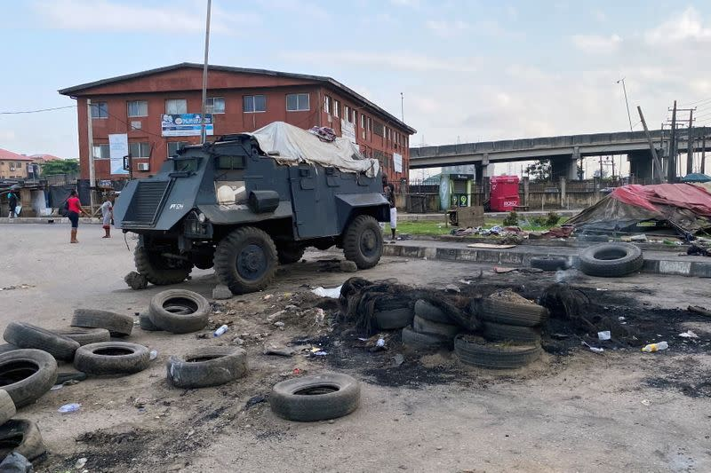 A police vehicle is pictured at a police checkpoint that was burnt down in Lagos