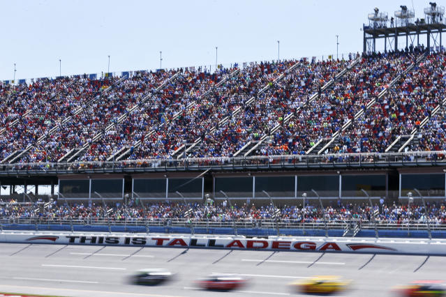 Drivers race past Talladega fans during a NASCAR Talladega auto race at Talladega Superspeedway, Sunday, April 29, 2018, in Talladega, Ala. (AP Photo/Brynn Anderson)