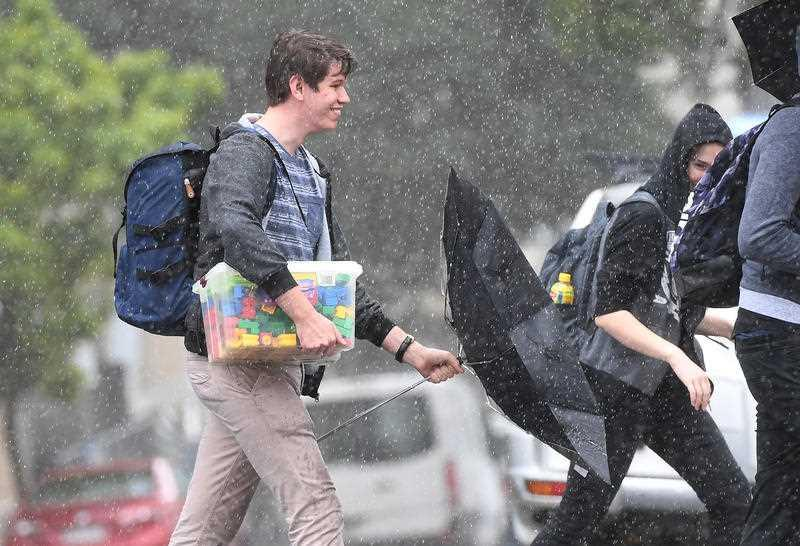 People walk in rainy weather in central Brisbane.