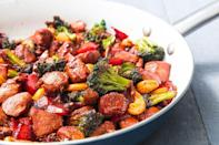 """<p>The best part of this chicken stir fry is how versatile it can be. Broccoli and bell peppers are great, but pretty much any vegetable you have in the fridge will work, too. <a href=""""https://www.delish.com/uk/cooking/recipes/g28757434/stir-fry-recipe/"""" rel=""""nofollow noopener"""" target=""""_blank"""" data-ylk=""""slk:Stir fry"""" class=""""link rapid-noclick-resp"""">Stir fry</a> is a Chinese method for cooking, usually in a wok over high heat. Here a cast iron or other heavy pan will work great!</p><p>Get the <a href=""""https://www.delish.com/uk/cooking/recipes/a33653203/chicken-stir-fry-recipe/"""" rel=""""nofollow noopener"""" target=""""_blank"""" data-ylk=""""slk:Honey Garlic Chicken Stir Fry"""" class=""""link rapid-noclick-resp"""">Honey Garlic Chicken Stir Fry</a> recipe.</p>"""