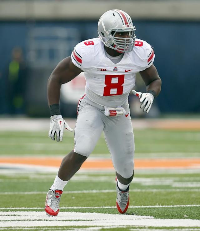 Ohio State defensive lineman Noah Spence (8) lines up against Illinois during the first half of an NCAA college football game on Saturday, Nov. 16, 2013, in Champaign, Ill. (AP Photo/Jeff Haynes)