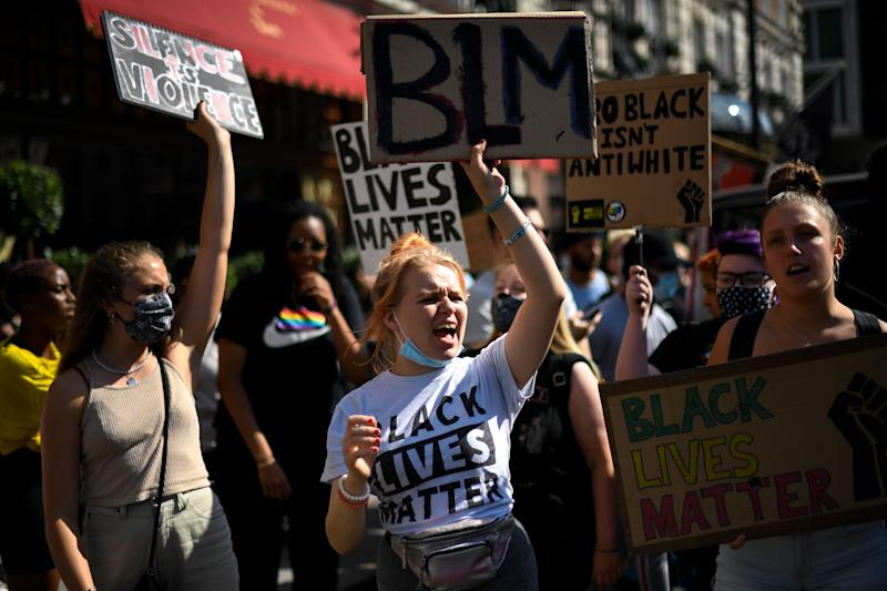 People march as they attend a Black Lives Matter protest in London (Photo: ASSOCIATED PRESS)
