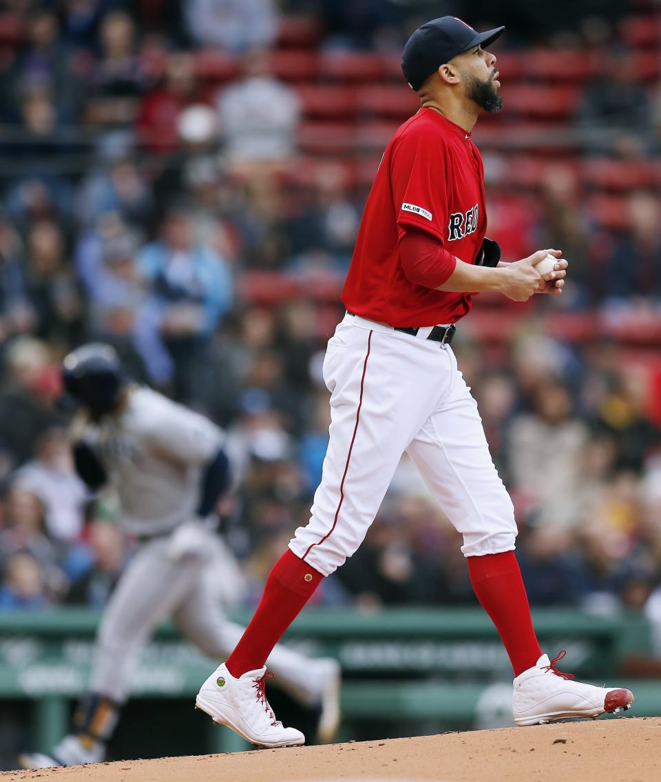 Boston Red Sox's David Price walks on the mound after giving up a solo home run to Tampa Bay Rays' Yandy Diaz, left, during the first inning of a baseball game in Boston, Saturday, April 27, 2019. (AP Photo/Michael Dwyer)