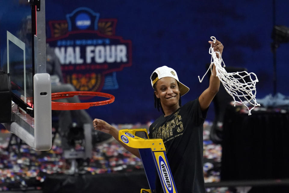 Stanford guard Kiana Williams (23) cuts down the net after the championship game against Arizona in the women's Final Four NCAA college basketball tournament, Sunday, April 4, 2021, at the Alamodome in San Antonio. Stanford won 54-53. (AP Photo/Eric Gay)