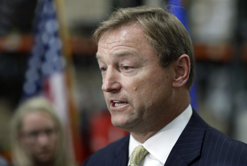 FILE - In this Aug. 28, 2017 file photo, Sen. Dean Heller, R-Nev., speaks at a news conference in Las Vegas. The most closely-watched race in Nevada's primary election Tuesday, June 12, 2018, is not GOP Sen. Heller's re-election battle - thanks to President Donald Trump - but instead is a contentious Democratic race for governor. (AP Photo/John Locher, File)