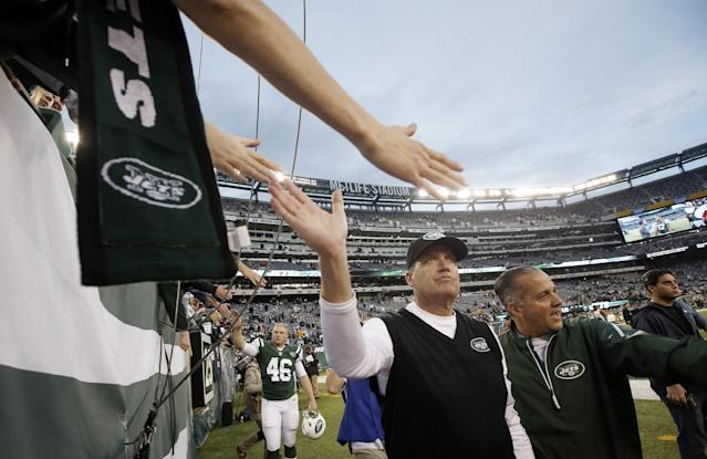 New York Jets head coach Rex Ryan, center, greets fans after an NFL football game against the Cleveland Browns, Sunday, Dec. 22, 2013, in East Rutherford, N.J. The Jets won the game 24-13. (AP Photo/Kathy Willens)