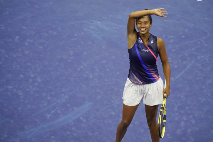 Leylah Fernandez, of Canada, reacts after defeating Naomi Osaka, of Japan, during the third round of the US Open tennis championships, Friday, Sept. 3, 2021, in New York. (AP Photo/Frank Franklin II)