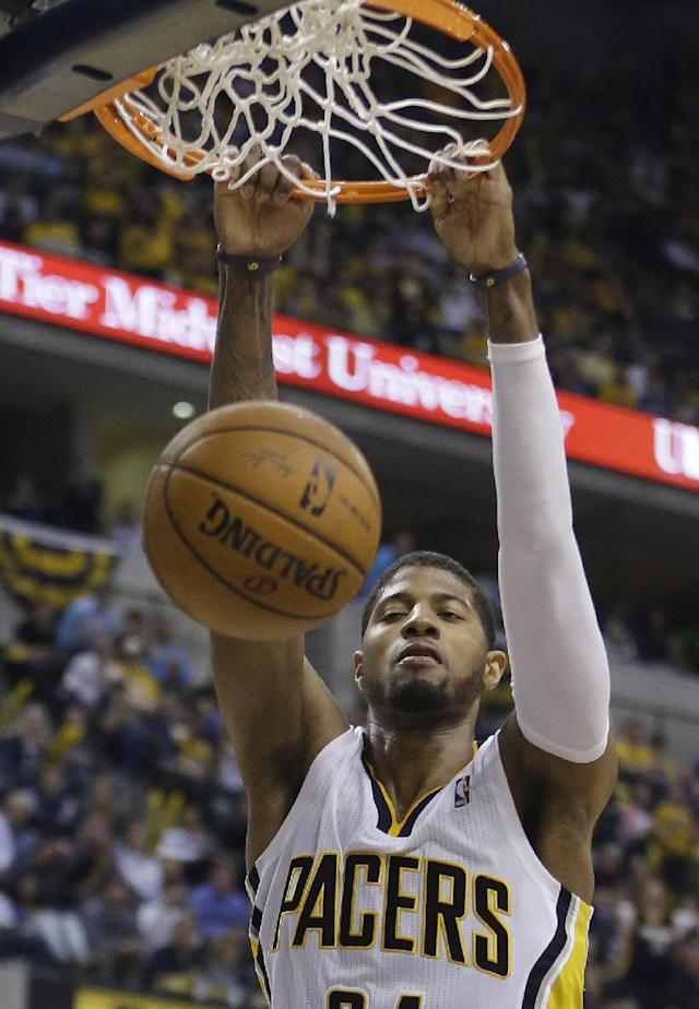 Indiana Pacers' Paul George dunks during the second half in Game 5 of an opening-round NBA basketball playoff series against the Atlanta Hawks Monday, April 28, 2014, in Indianapolis. Atlanta defeated Indiana 107-97. (AP Photo/Darron Cummings)