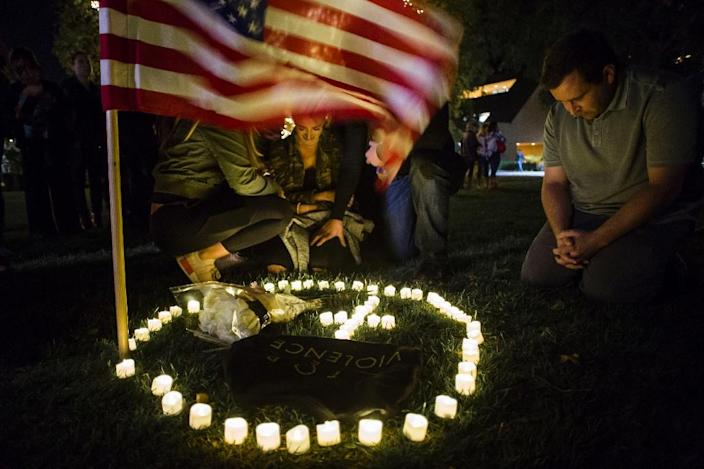 A vigil in honor of 12 people killed in a California bar shooting in November 2018 -- even the most shocking of massacres can fail to move the needle on gun control in America (AFP Photo/Apu Gomes)