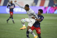 Montreal Impact forward Mason Toye (13) and New England Revolution forward DeJuan Jones (24) vie for the ball during the second half of an MLS soccer match, Friday, Nov. 20, 2020, in Foxborough, Mass. The Revolution won 2-1. (AP Photo/Stew Milne)