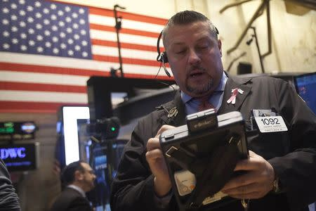 Trader works on the floor of the New York Stock Exchange in New York