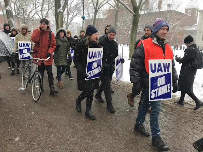 Harvard University graduate student workers picket at Harvard Yard Tuesday as they go on strike.