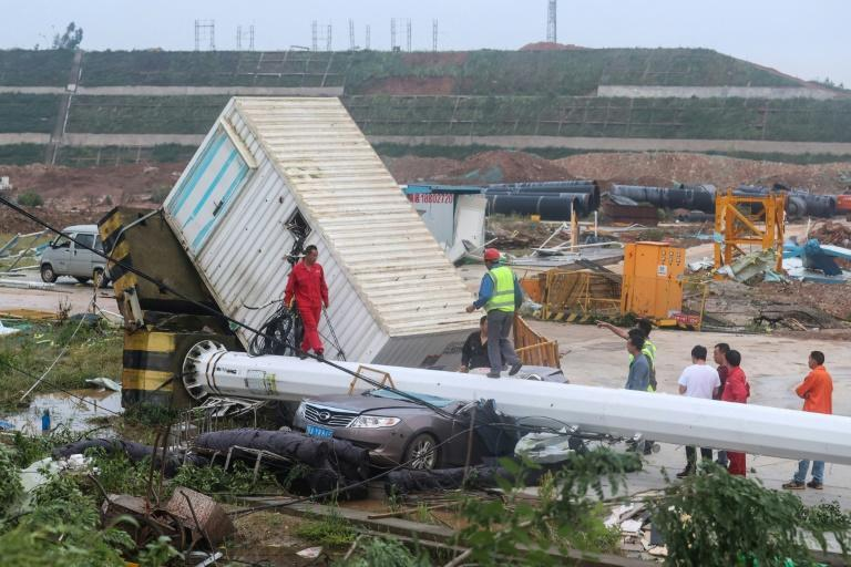 A tornado packing winds of more than 260 kph (160 mph) hit Wuhan, leaving eight dead and hundreds injured