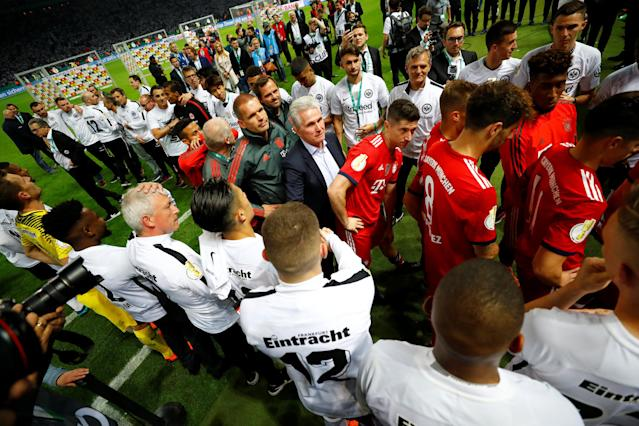 Soccer Football - DFB Cup Final - Bayern Munich vs Eintracht Frankfurt - Olympiastadion, Berlin, Germany - May 19, 2018 Bayern Munich coach Jupp Heynckes and players during the ceremony after the match REUTERS/Kai Pfaffenbach DFB RULES PROHIBIT USE IN MMS SERVICES VIA HANDHELD DEVICES UNTIL TWO HOURS AFTER A MATCH AND ANY USAGE ON INTERNET OR ONLINE MEDIA SIMULATING VIDEO FOOTAGE DURING THE MATCH.